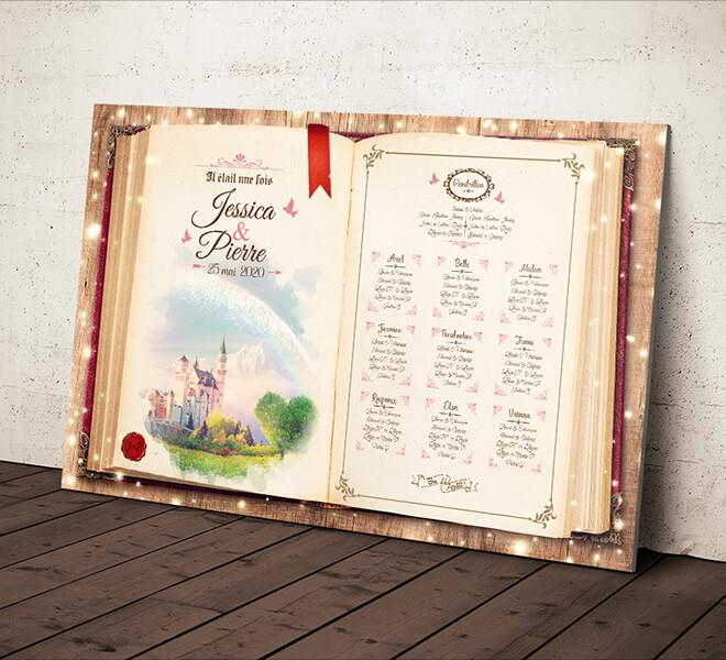 Plan de table de mariage original sous forme de livre de conte de fées Style château de la Belle au bois dormant Disney pour un mariage sur le thème Cendrillon romantique © www.alpagart.fr