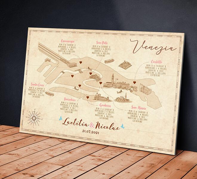 Plan de table de mariage original sous forme de carte de Venise avec les quartiers pour chaque table pour un mariage sur le thème du voyage, fond effet parchemin © www.alpagart.fr